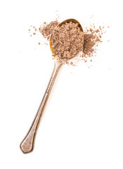 ground cinnamon powder in a spoon