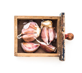 cloves of garlic in a box