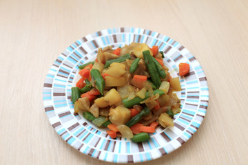 Plate with vegetable stew