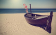 Retro toned picture of fishing boat on the beach. - 79514976