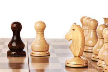 Black and white chessmen on chessboard