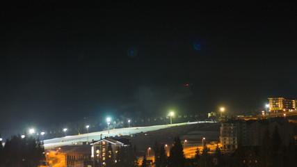Night ski trail with ski runs. Time lapse 4K