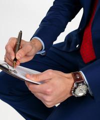 Businessman writes the document