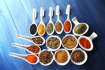 Different kinds of spices in ceramics spoons, close-up,