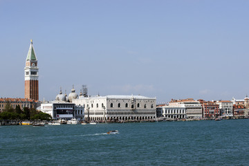 Schiavoni quay, doges palace and water traffic in summer Venice