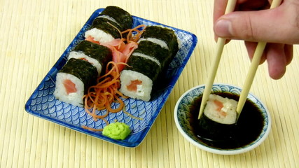 Salmon Sushi Maki Roll Eating