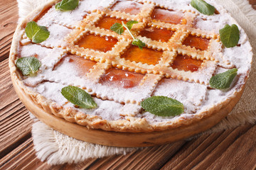 Italian tart with apricot jam and mint close up horizontal