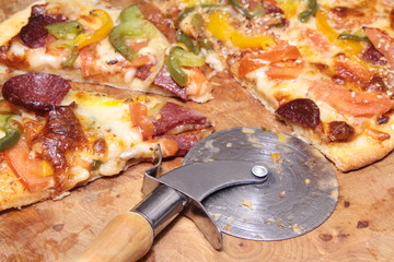 Pizza and cutter