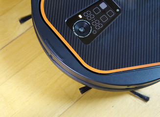 the robot the vacuum cleaner cleans a floor,