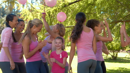 Smiling women in pink for breast cancer