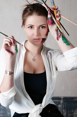 beautiful young woman painter in her studio