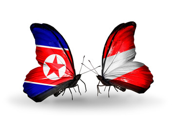 Two butterflies with flags North Korea and Austria