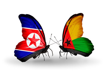 Two butterflies with flags North Korea and Guinea Bissau