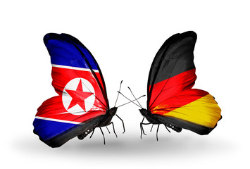 Two butterflies with flags North Korea and Germany