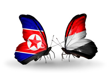 Two butterflies with flags North Korea and  Yemen
