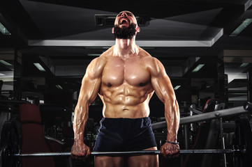 Muscular Man Lifting Barbells