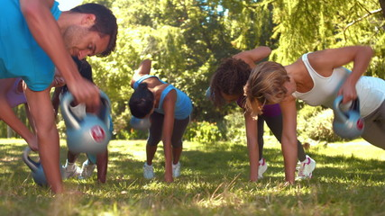 In high quality format fitness group planking in park