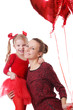 Daughter and mother with red balloons