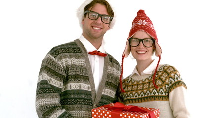 In slow motion geeky hipster couple holding present