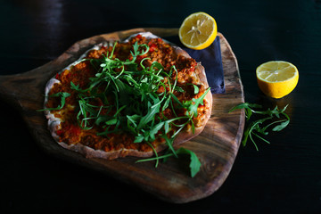 Thin turkish pizza with minced meat, lemon and arugula