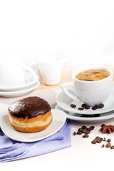 Breakfast with donut and cup of espresso coffee
