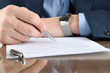 Businessman is signing a contract, business contract details - 79525564