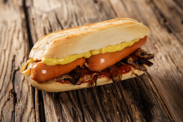 Hot dog on wooden table.