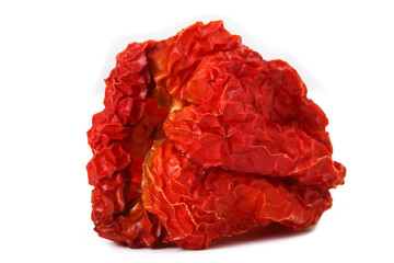 Dried red peppers on the white background