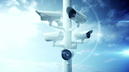 CCTV cameras against blue sky