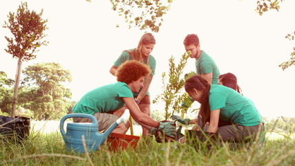 In slow motion happy friends gardening for the community