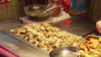 Dumplings grilling at vendor in Lehua Night Market in the Yonghe