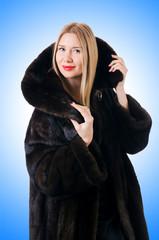 Tall model wearing fur coat