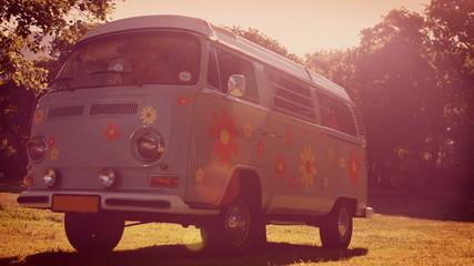 In high quality format retro camper van in a field