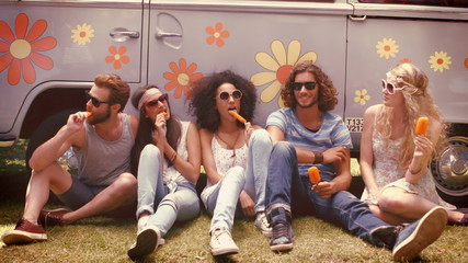 In high quality format hipster friends enjoying ice lollies