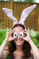 Woman Wearing Rabbit Ears and Silly Egg Eyes