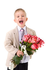 Laughing little gentleman standing with big bouquet of red roses