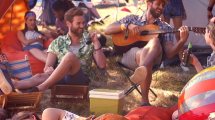 In high quality format pretty hipster relaxing on campsite