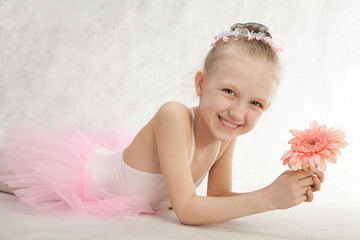 Little cute ballet-dancer with flower in the tutu