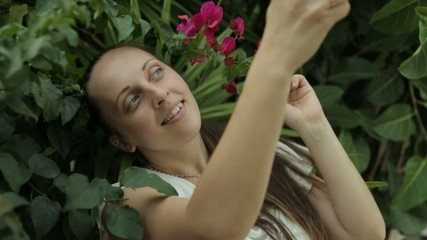Girl doing self with flowers