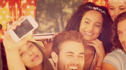 Hipsters taking a selfie in camper van