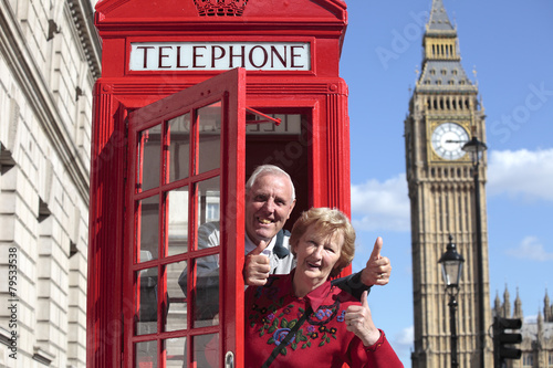 Senior couple with red telephone box in London - 79533538