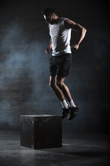 Athlete gave exercise. Jumping on the box. Phase touchdown. Stud