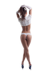 Rear view of slim woman in sexy bridal accessories