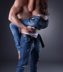 Passionate embrace of sexy models in jeans