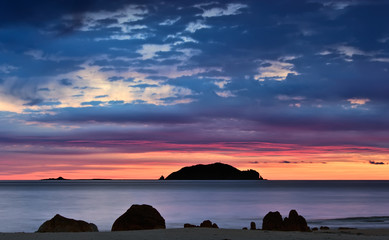Bright sunrise over the coast of the East Sea.