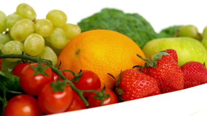 Bowl of fruit and vegetables on white background