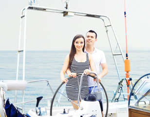 Young and lovely couple relaxing on a boat