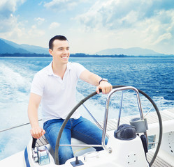 A handsome man sailing in the sea