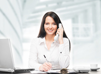 Young and attractive businesswoman working in office