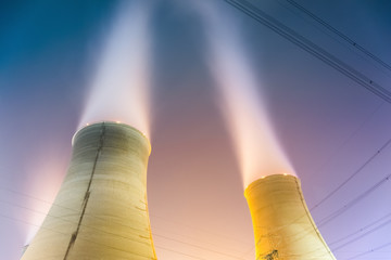 cooling towers at night
